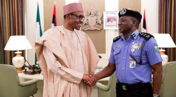 KP3 President Buhari exchange pleasantries with Acting Inspector General of Police, Ibrahim Kpotun Idris at the state house, Abuja.
